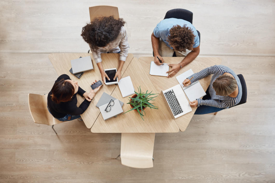 employees working together at one desk